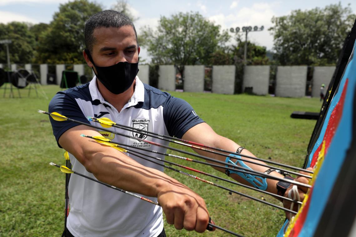Danny Quintero collects arrows at the practice field in Medellin, Colombia.