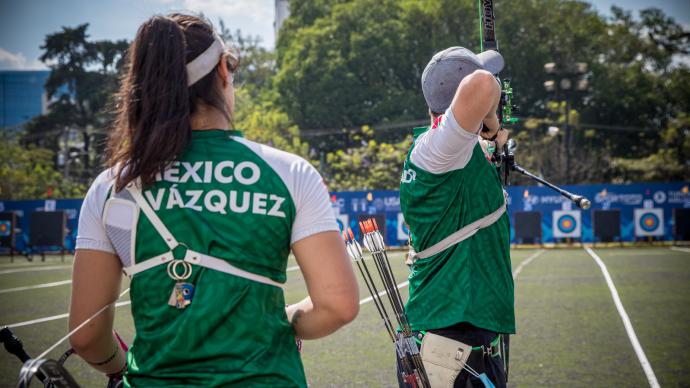 Mexico's Ana Vazquez and Angel Alvarado shoot in the mixed team eliminations at the first stage of the 2021 Hyundai Archery World Cup in Guatemala City.