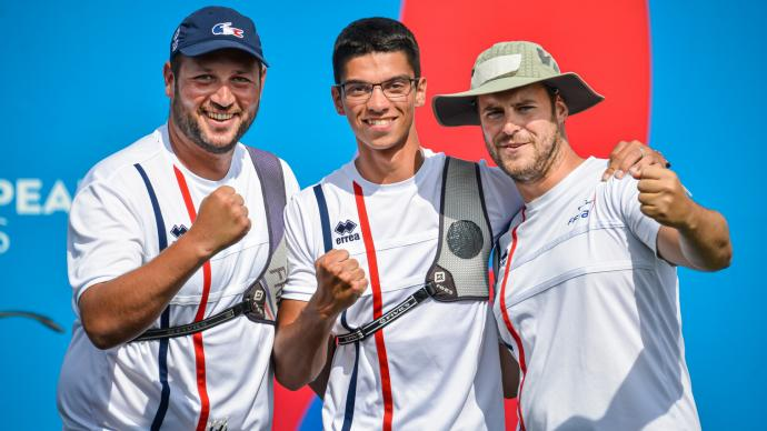 The French recurve men celebrate winning team gold at the European Games in 2019.