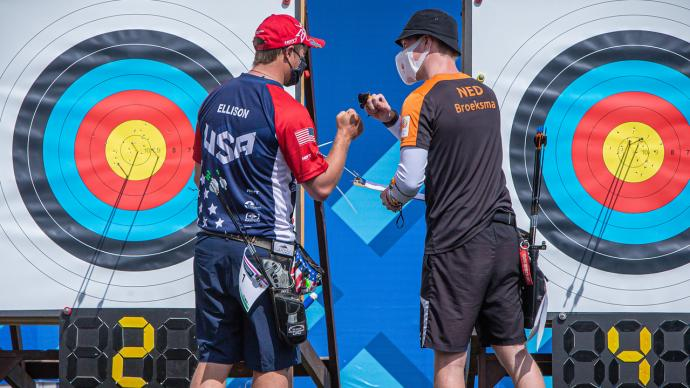 Brady Ellison and Gijs Broeksma bump fists after their eliminations match at the first stage of the 2021 Hyundai Archery World Cup in Guatemala City.