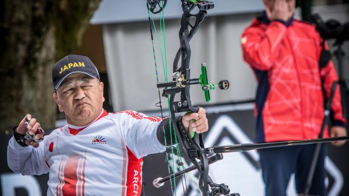Yoshitsugu Naka shoots during the World Archery Para Championships in 2019.